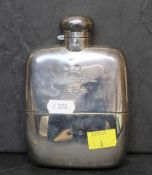 An Edward VII silver hip flask with slightly curved body and integrated cup, 14.