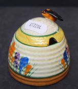 """A Clarice Cliff bizarre pottery """"Spring Crocus"""" pattern honey jar and cover 7."""