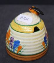 "A Clarice Cliff bizarre pottery ""Spring Crocus"" pattern honey jar and cover 7."