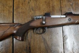 Parker Hale cal 243 bolt action rifle, fitted with a sound moderator and with floor plate magazine.