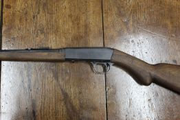 Fabrique Nationale (Browning) cal 22LR, semi automatic rifle fitted with a sound moderator.
