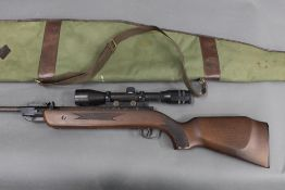A Chinese cal 22 break barrel air rifle, fitted with a Viking 4 x 40 telescopic sight. Serial No.
