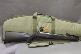 SMK Synsg cal 22 break barrel air rifle, with a synthetic stock, sold with an SMK gun slip,
