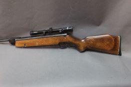Webley Vulcan cal 22 break barrel air rifle, fitted with an Enfield 4 x 20 telescopic sight.