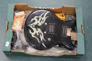 Two electric guitar bodies, switches, rack accessories and other guitar parts.