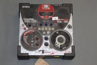 A Yamaha DJX- II B , 33 cm2.