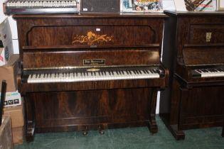 An Edwardian grained walnut John Spencer & Co upright piano retailed by Murdoch,