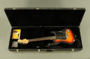 A Westfield 6 string electric guitar, 99 cm long with shoulder strap,