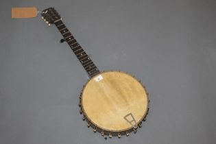 A vintage banjo, the neck inset with mother of pearl and with metal framed body, 74 cm long.