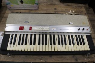 WITHDRAWN- A vintage WEM Teischord C keyboard, contained in fitted case,