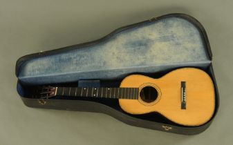An early 20th century CF Martin & Co of New York acoustic guitar with wide neck,