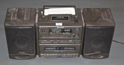 A Sharp X-Base CD radio cassette player.