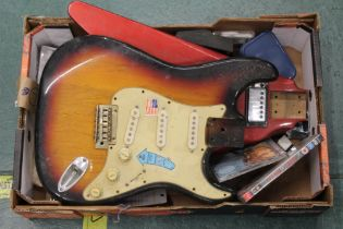 A Fender S-1 electric guitar body, one other electric guitar body and mixed guitar items.
