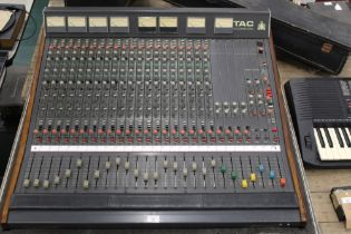 A TAC Scorpion 20 channel mixing desk with teak edging, 92 cm wide (no PSU),