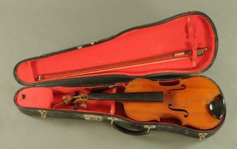 A 19th century full size violin with figured one piece back,