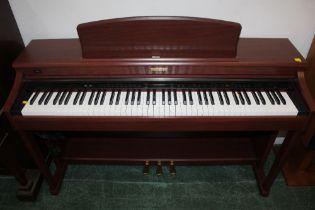 A Kawai mahogany finish CN42 digital piano, 140 cm wide,