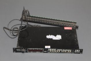 A vintage XRI systems XR 300 SMPTE synchroniser complete with patch bay