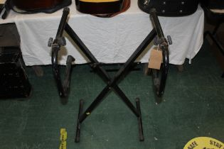 A vintage MPM black painted metal folding double keyboard stand.