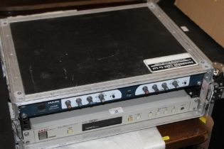 A Pulse CX-Pro two channel stereo crossover and a Akai Professional ME30P programmable Patch Bay,