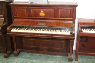 An Edwardian inlaid mahogany Kent and Cooper of Lincoln upright piano, 144 cm wide.