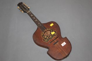 An old 8 string flat back mandolin with shaped body,