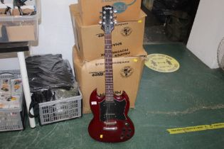 A Gibson Epiphone electric guitar with cherry lacquered body No. 90020688, 100 cm long.
