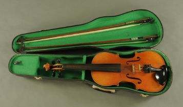 A 19th century full size violin with figured two piece back,