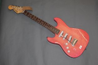 A Lindo left handed electric guitar with pale pink lacquered body, 99 cm long.