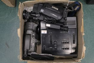 Two vintage Sony Camcorders and a Sony Video camera selector.