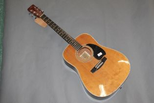 A Hohner Arbor acoustic guitar, 104 cm long.
