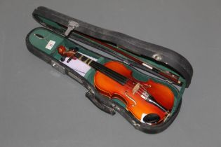 A Chinese Skylark brand child's 1/8 size violin, together with bow and case for same,