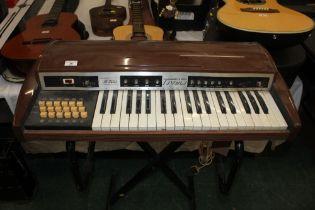 A vintage brown plastic cased Eko Tivoli 18R electric keyboard, 78 cm wide.