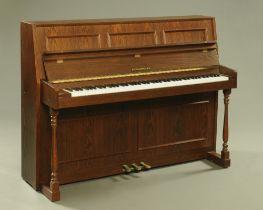 A modern Fazer oak finish upright piano, 141 cm wide.