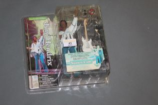A McFarlane toys model of Jimi Hendrix in concert on August 18th 1969 at 0804 am,