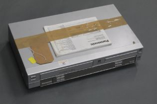A Panasonic NV-VP31 Super Drive DVD / CD / Video cassette recorder, with instructions.