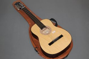 A Hohner MC-03 acoustic guitar with inlaid body, 97 cm long with case for same.