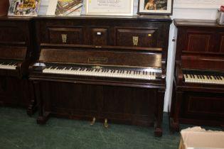 An Edwardian figured walnut John Spencer & Co upright piano, retailed by Murdoch,