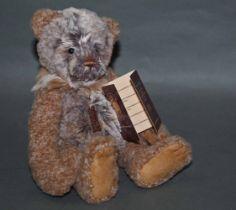 "A soft plush ""Benny"" Charlie Bear, CB171779A, having brown and grey tinged fur body,"