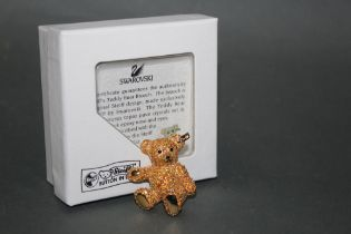 A Steiff gold coloured teddy bear brooch, made exclusively for Steiff by Swarovski,