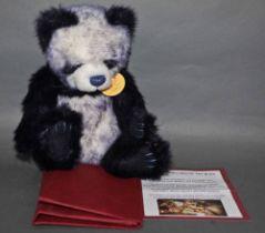 "A soft plush ""Tiffy"" Charlie Bear, CB604686, having navy blue and white fur body,"