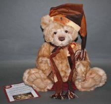 """A soft plush """"Santa Paws"""" Charlie Bear, CB621390, having beige fur covered body,"""