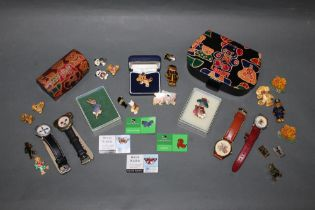 A group lot teddy bear and other associated brooches, wrist watches and decorative cases,