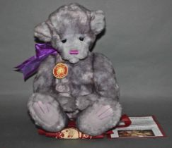 """A soft plush and """"Pattercake"""" Charlie Bear, CB135011, having grey fur covered body,"""