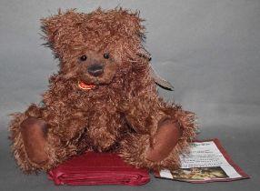 "A soft plush ""Kelvin"" Charlie Bear, CB614849, having shaggy brown fur covered body,"