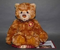 "A soft plush ""Lionheart"" Charlie Bear, CB131326, having a golden or blonde fur covered body,"