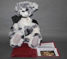 "A soft plush ""Inkspot"" Charlie Bear, CB620009, having black, white, and grey fur covered body,"