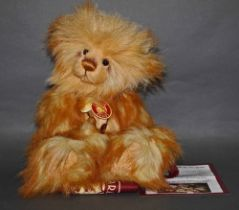 "A long and soft plush ""Golddust"" Charlie Bear, CB104715, having a long golden fur covered body,"