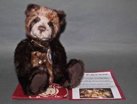 "A soft plush ""Joy"", Charlie Bear, CB094081A, having brown and cream fur covered body,"