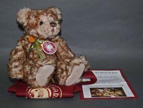 "A soft plush ""Button"" Charlie Bear, CB194513, having a light brown and beige ruffled fur body,"