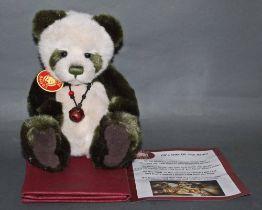 "A soft plush ""Mistletoe"" Charlie Bear, CB614989, having green and white fur covered body,"